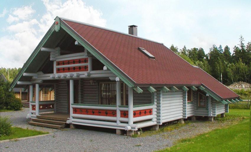двуетажна къща от дървени цилиндровани трупи